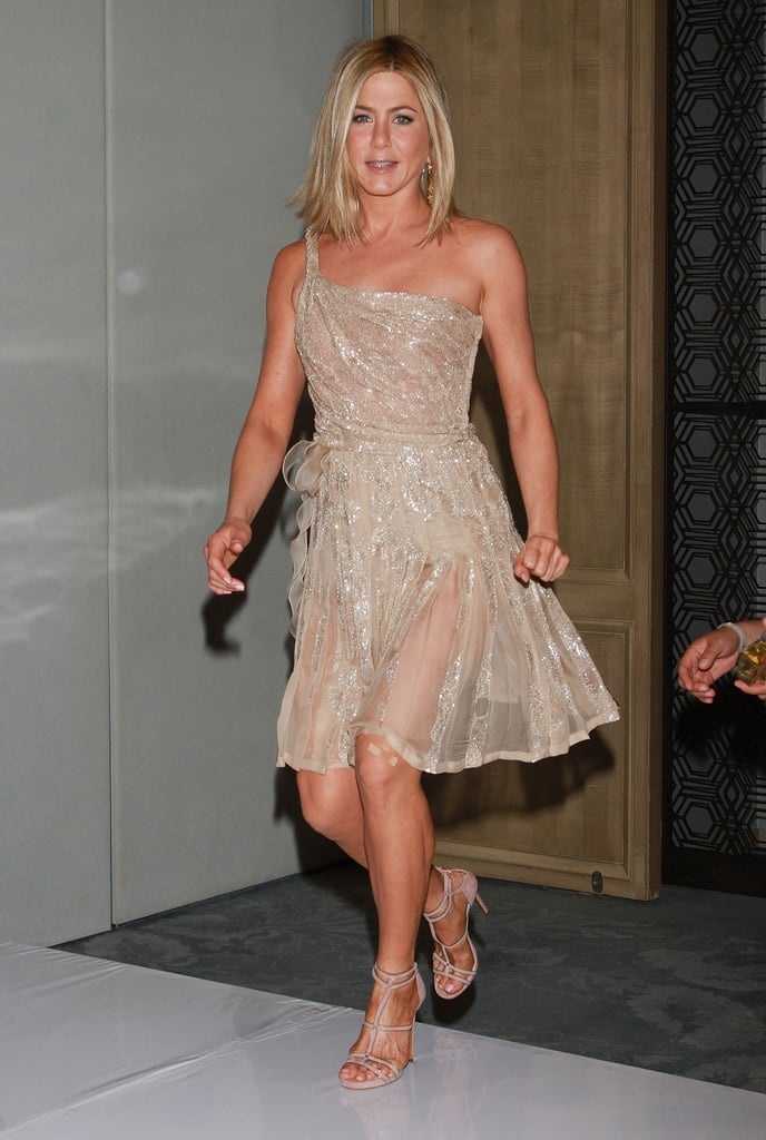 Jennifer Aniston glowed while promoting her fragrance in Mexico — we love the semi-sheer skirt here.