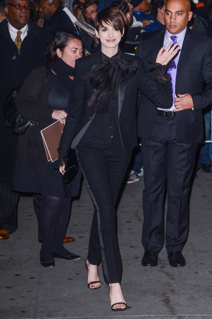 Anne's all-black Saint Laurent suit and ankle-strap Givenchy sandals prove head-to-toe black is always très chic.