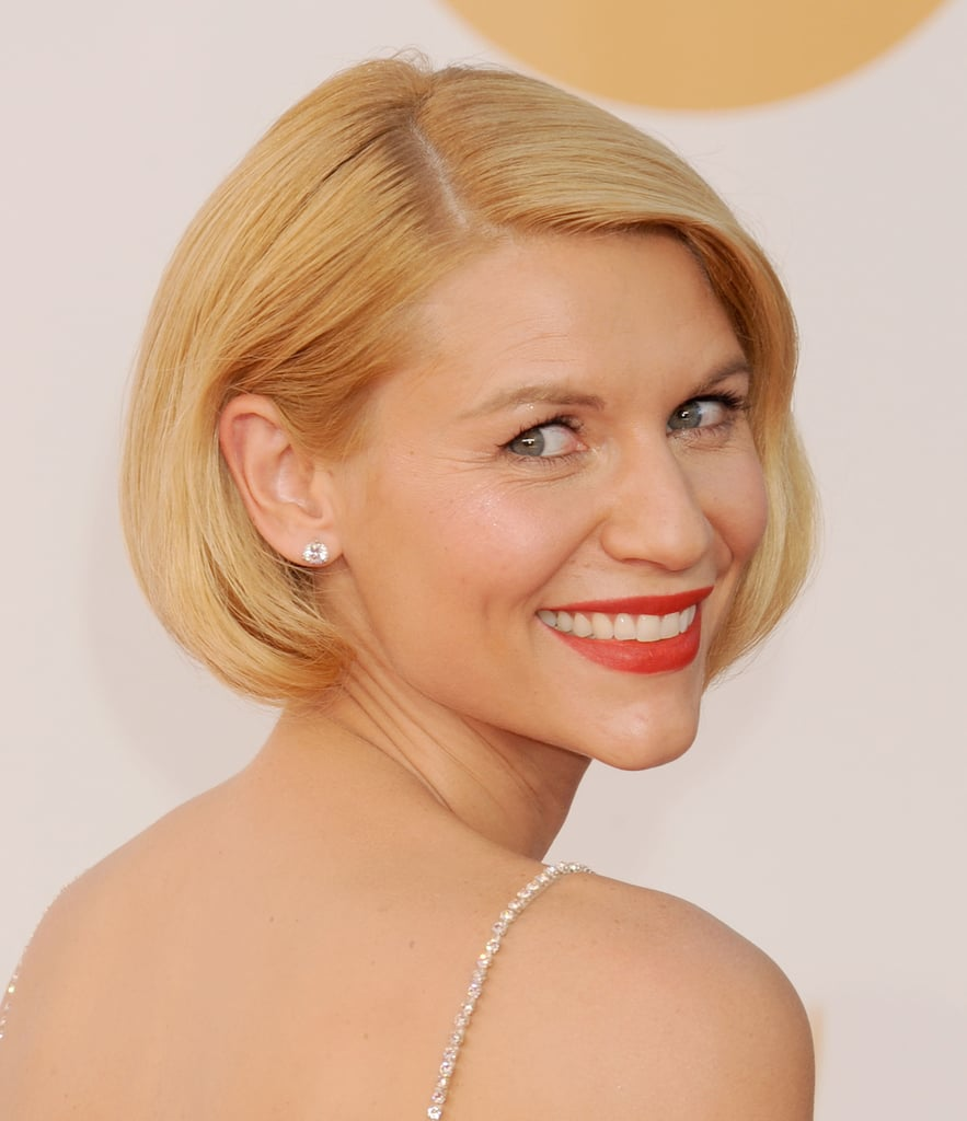 Claire Danes made sure the delicate diamante straps of her Emmy Awards gown got plenty of attention by sweeping her hair up and under in a very sleek and simple faux bob. Use a big round brush to blow dry hair smooth, but with plenty of body, as the base for this look. If you keep rolling the ends under as you dry, guiding the hair into a roll at the neck should be really easy once the hair is dry.