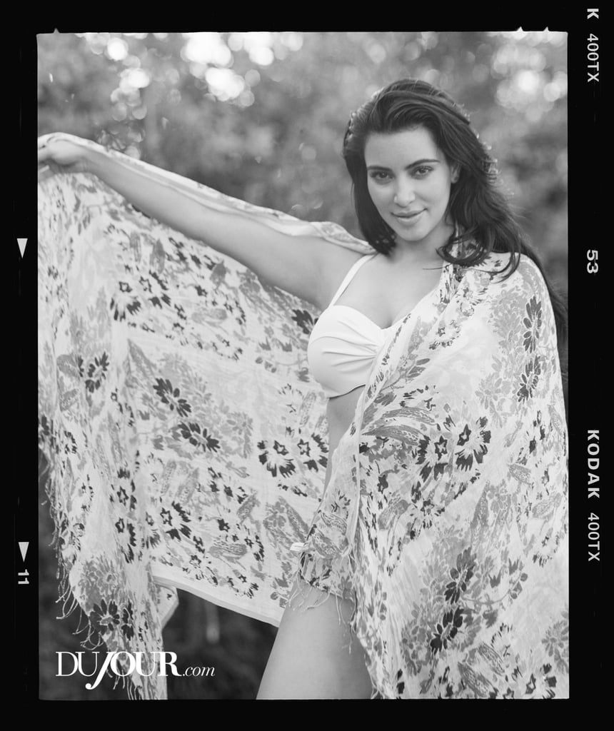 Pregnant Kim Kardashian wore a white bikini for DuJour magazine's Spring 2013 issue.