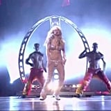 "2000: Britney then gave us the first of many iconic VMAs moments with her performance of ""Oops! . . . I Did It Again."""