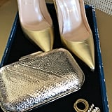 Olivia's Accessories Include Gold Christian Louboutin Pigalle Pumps