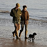 Kate Middleton and Prince William gave their black Cocker Spaniel puppy its first public appearance on a beach walk.
