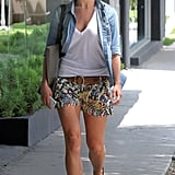 During a stroll in LA, Julianne Hough finished her printed shorts and white tee with a denim button-down. Do the same next time you need a light cover-up.