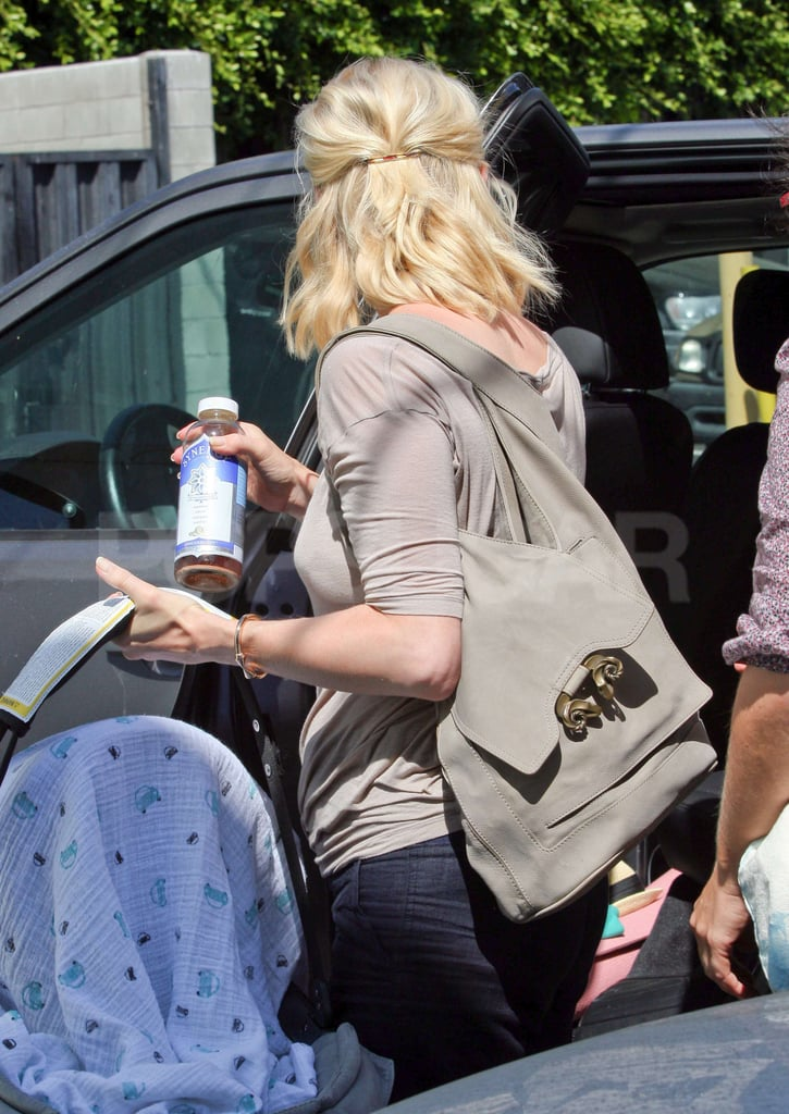 January Jones got help putting her new baby in her car.