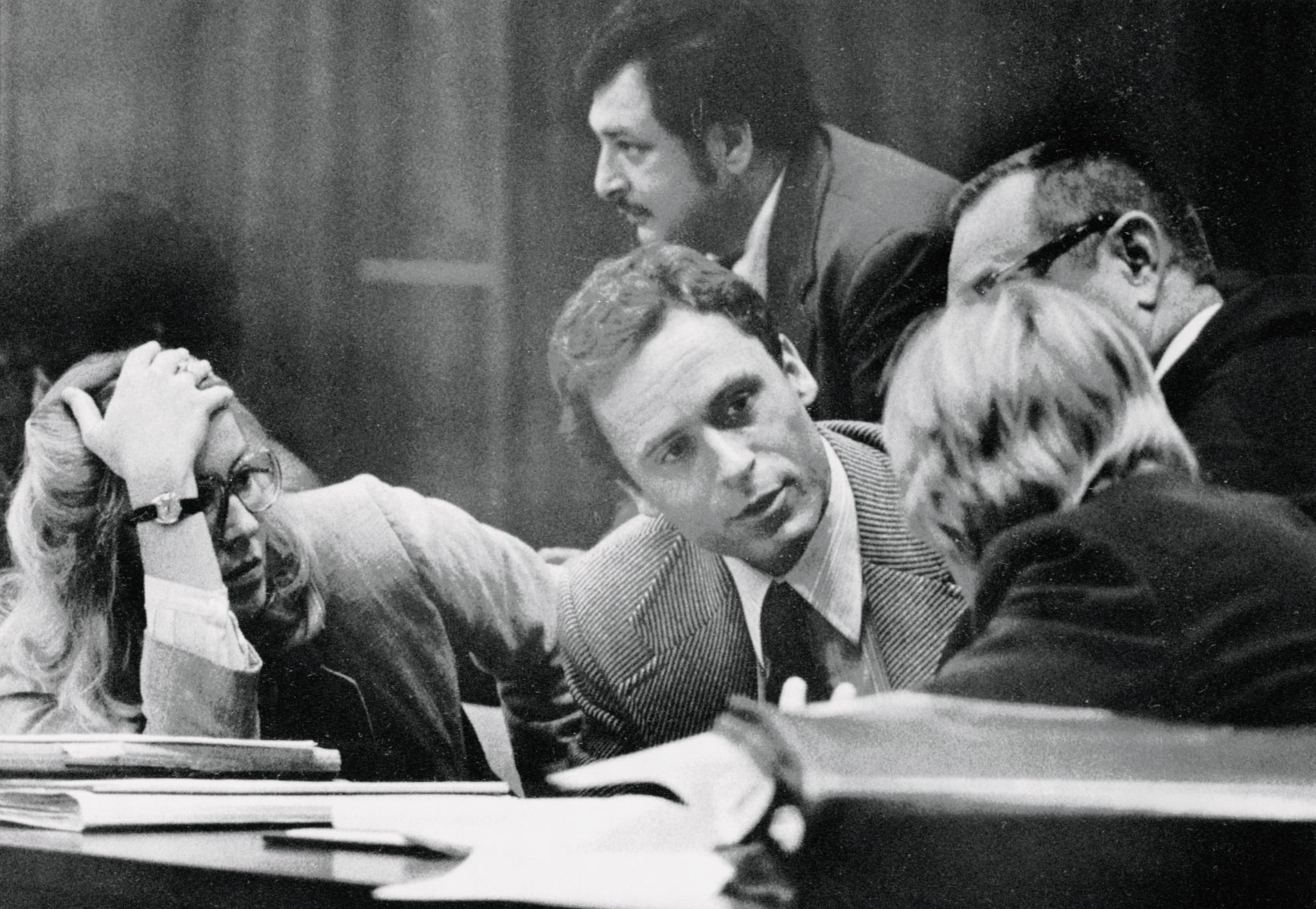 (Original Caption) Accused murderer Theodore Bundy (C) confers with his defence attorneys on the opening day of his trial 6/25. The trial will be televised nationwide as Bundy participates in his own defence, drawing on his experience as a law student. Bundy is accused of killing two FSU coeds.