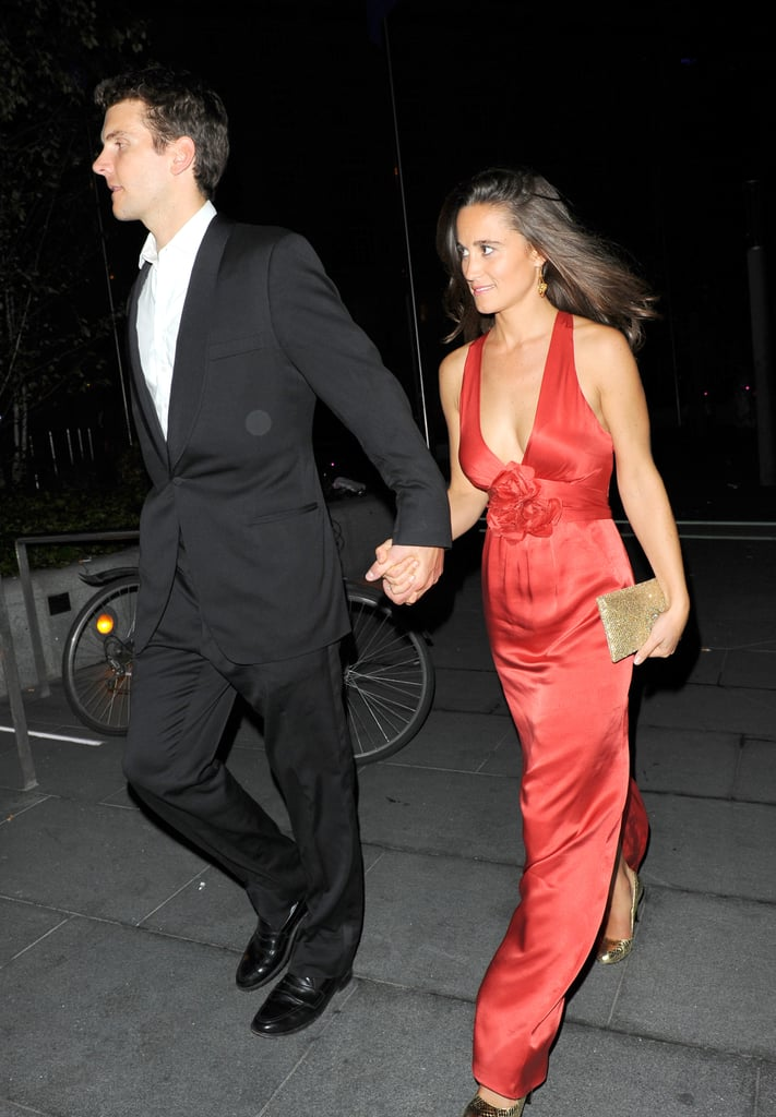 Pippa Middleton and Alex Loudon hold hands.