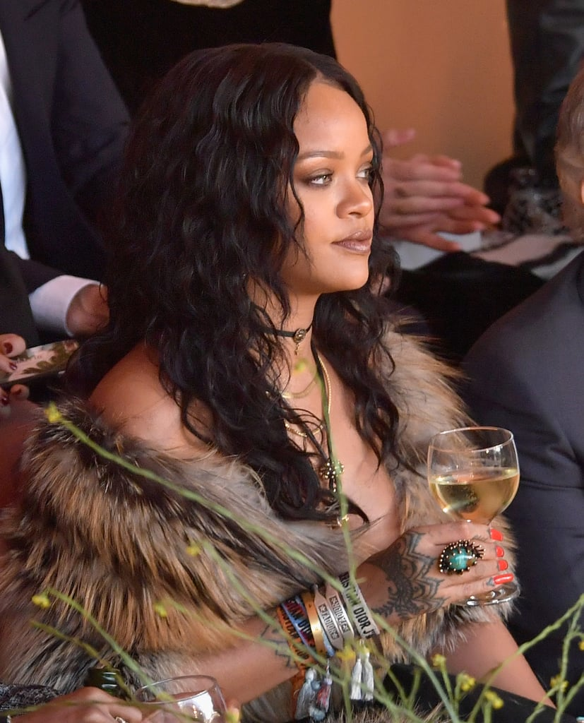 "Rihanna showed up in style for Dior's Cruise 2018 runway show in Calabasas, CA, on Thursday. The ""Work"" singer rocked her cowgirl finest as she walked into the function with a hair flip, then shared a laugh with Kelly Rowland before taking her seat in the front row next to rapper Big Sean. In true Rihanna fashion, she held on to a glass of white wine as she took in the show — remember, this is the same legend who brought her own flask to the Grammys, so . . .   Rihanna has been having an exciting May; she recently shut down the Met Gala with her jaw-dropping Comme des Garcons look and linked up with pal Lupita Nyong'o inside for some much-needed selfies, and she dropped new styles for her Fenty x Puma line days later. Keep reading to see Rihanna's night out for Dior.      Related:                                                                                                           18 Rihanna Quotes That Will Inspire You to Just Live Your Life"