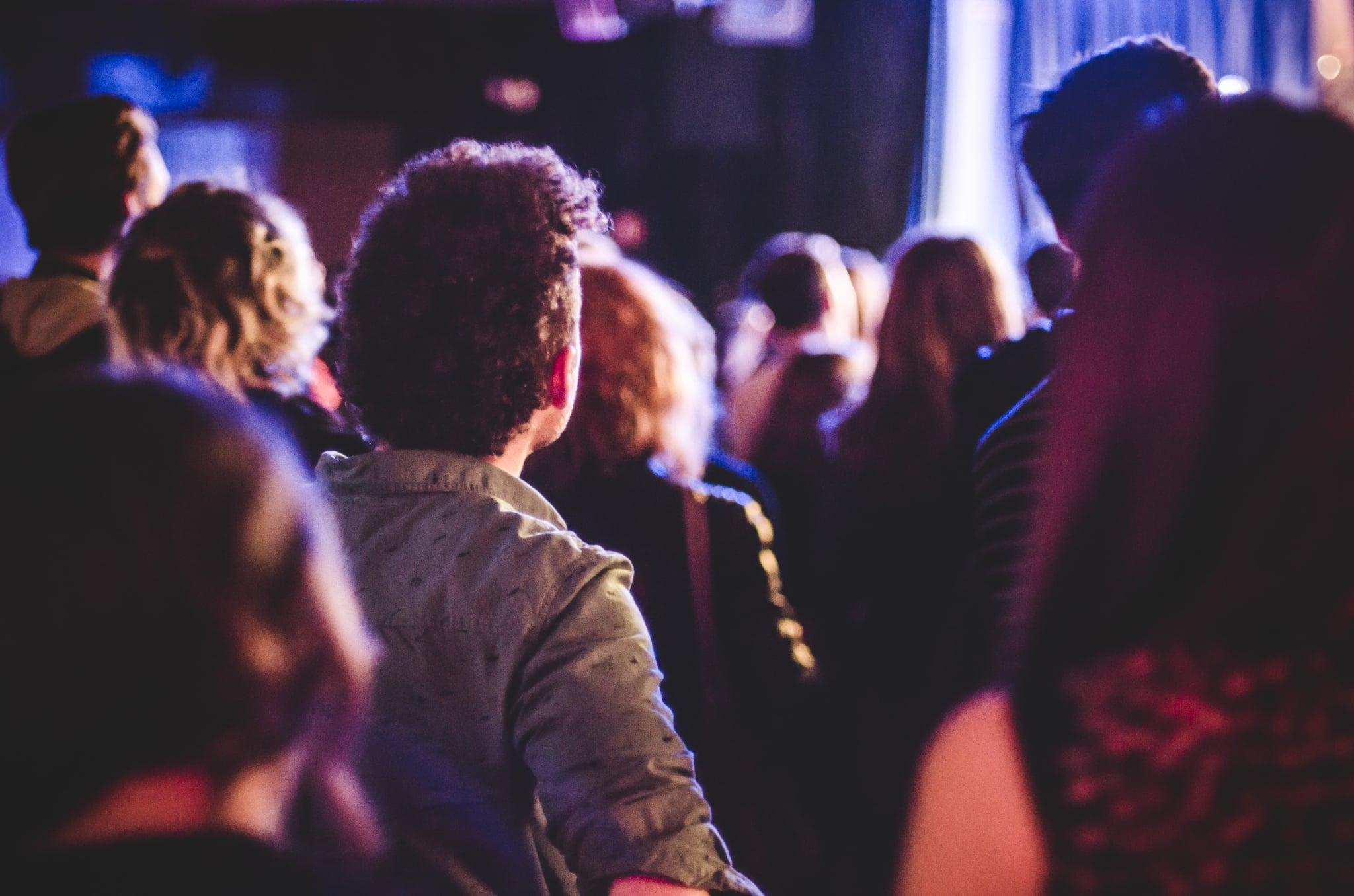 Crowd of People Watching Concert in Small Club Venue. (Photo by: GHI/Education Images/Universal Images Group via Getty Images)