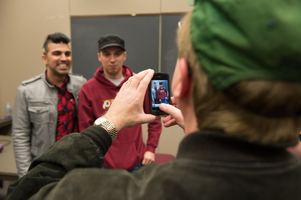Bobak Ferdowsi, NASA Mars Curiosity Landing mission controller, poses with a guest at the NASA Star Party held at Washington-Lee High School during inauguration weekend.  Source: Flickr User NASA HQ