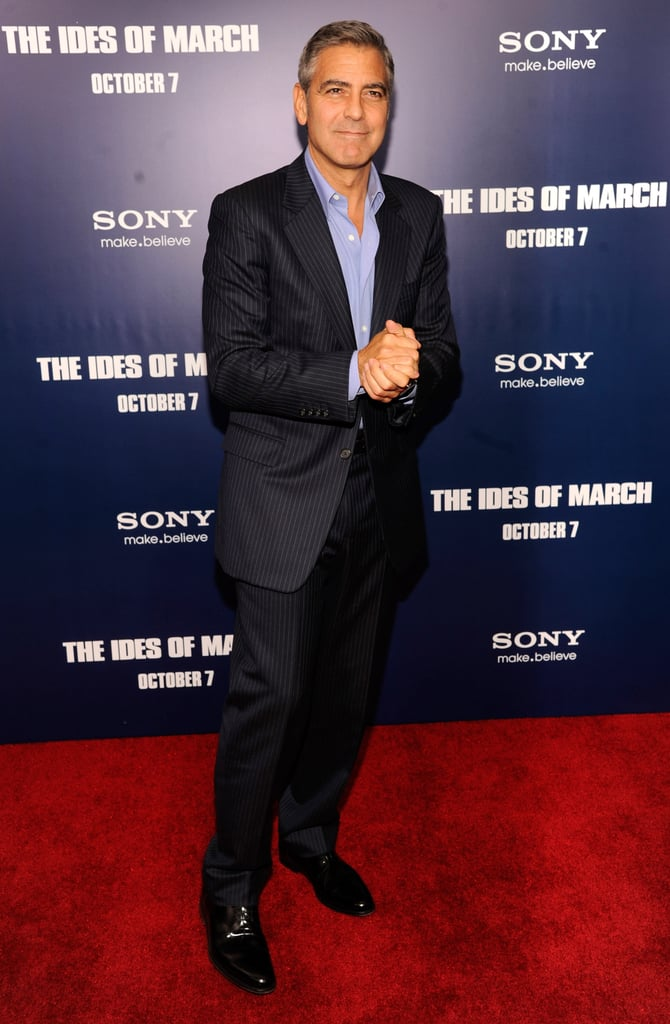 George Clooney taking his turn on the red carpet at the premiere of The Ides of March in NYC.