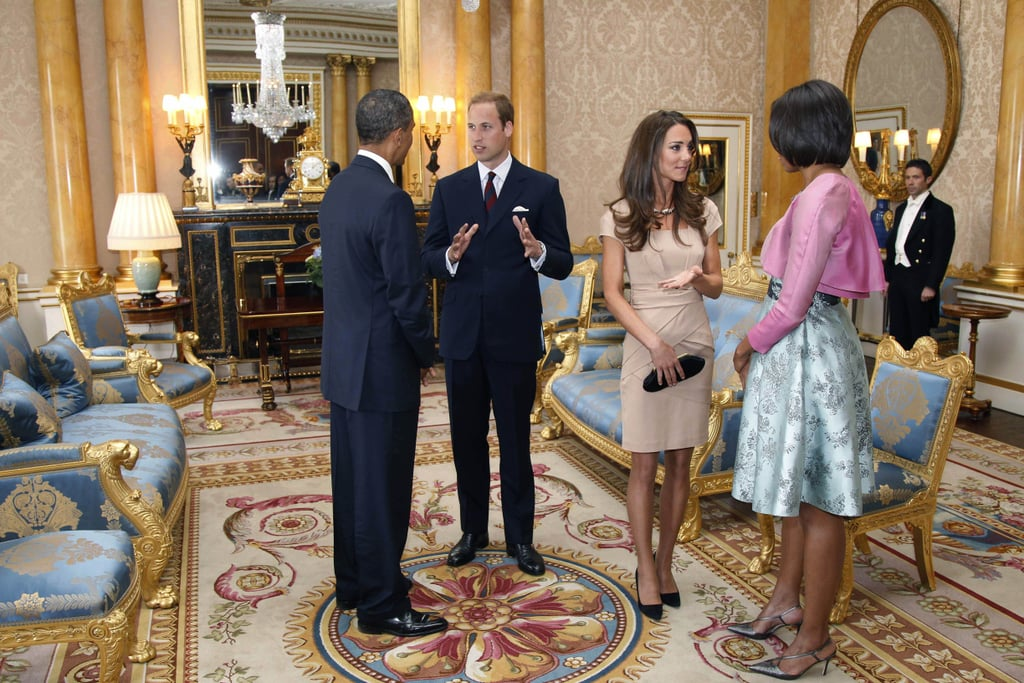 Kate Middleton, in Reiss, assumed her first royal duty this morning by joining her husband, Prince William, to welcome President Obama and First Lady Michelle Obama to the UK. The Duke and Duchess of Cambridge are home again following a 10-day honeymoon in the Seychelles, and they left with  a special gift from the ruler of the remote island nation. The president and first lady, making the third official visit from a sitting head of state to Britain in 100 years, were first greeted by Queen Elizabeth and Prince Phillip, who is to celebrate his 90th birthday on June 10. William and Kate apparently discussed their upcoming California tour with the Obamas, then sat down to a lunch hosted by the queen. The president and first lady had to rearrange their travel plans and move their trip forward due to worries about how ash from the latest Iceland volcano will affect flying conditions. The Obamas are staying at Buckingham Palace for two nights, and this evening will dine at a royal banquet that William and Kate are not expected to attend.