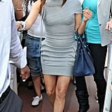 Eva made her way off the sidewalk wearing a gray Herve Leger and blue Birkin.