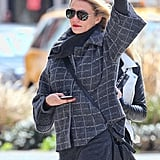 Cameron Diaz tried to hail a cab in NYC in a gray jacket and jeans.