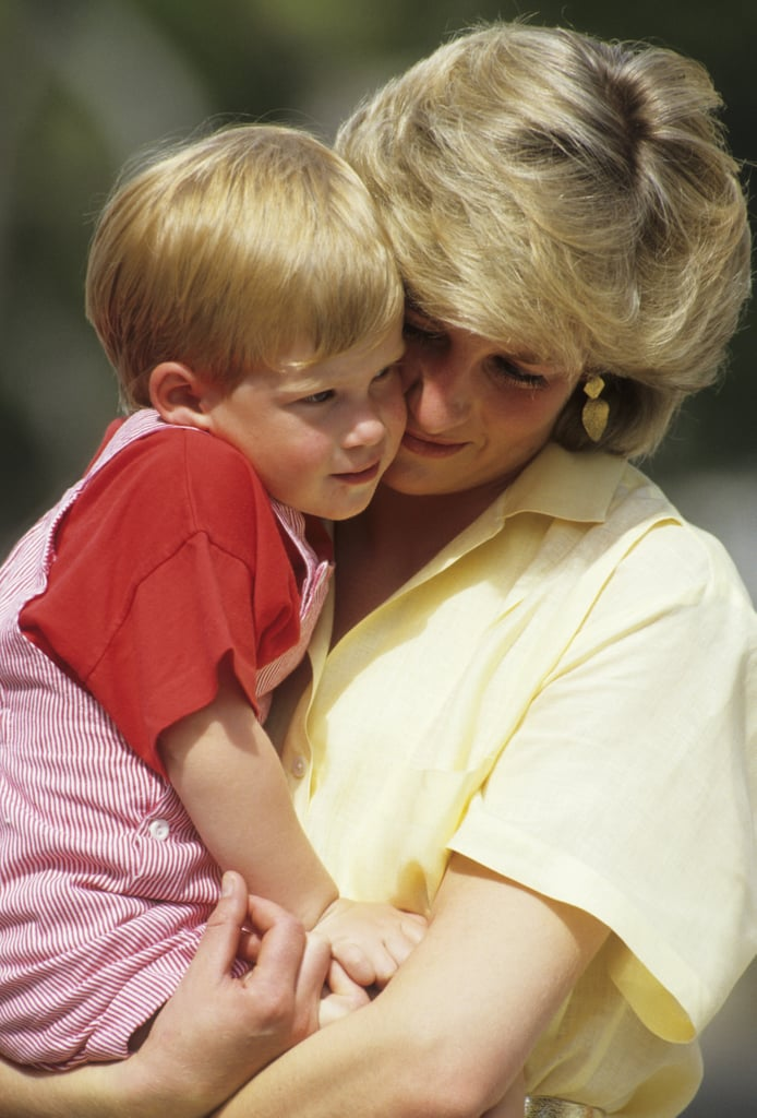 Prince Harry snuggled up to his mom during a holiday in Majorca, Spain, in August 1987.