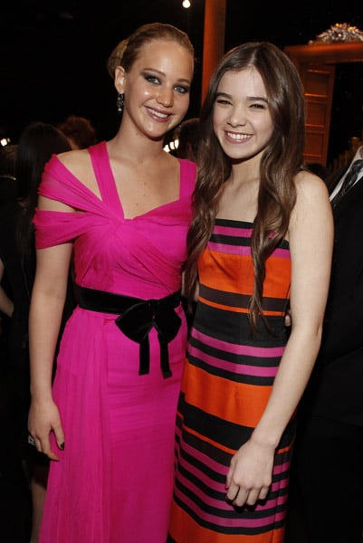 Jennifer Lawrence's hot-pink Oscar de la Renta and Hailee Steinfeld's colorful striped Prada look so good together!