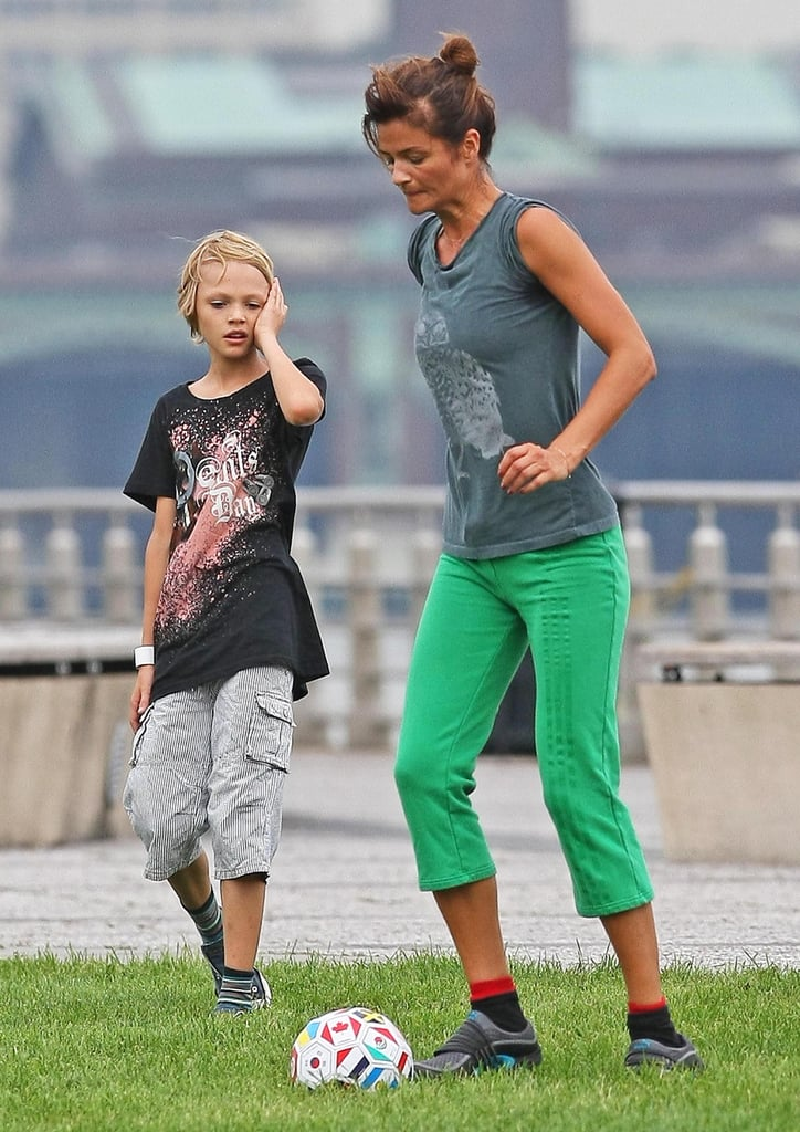 Helena Christensen is not only a soccer-watching mom. She got onto the field to dribble the ball a bit with her son, Mingus.