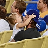 Harper Beckham played with her dad David Beckham's hat in the stands of the LA Dodgers game.