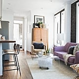 Justin selected a purple sofa from AllModern as a focal point for Lo's living room.