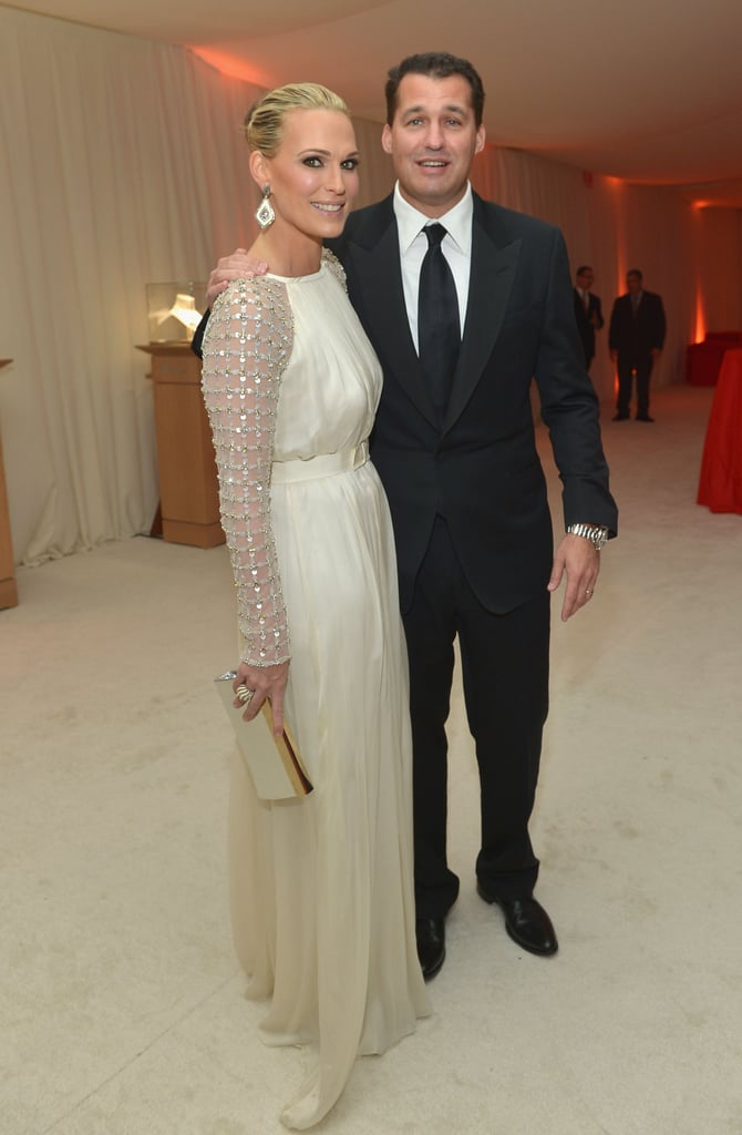 Molly Sims and husband Scott Stuber posed together at Elton John's Oscar party.