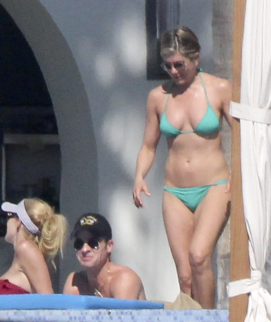 And the Mexican getaway continues! Jennifer Aniston emerged recently in a bright green bikini in Cabo, determined to soak up every drop of sunshine with Justin Theroux. It's been a couple days since their arrival in Cabo San Lucas this past weekend, and the couple has been scoring rays left and right with pals Courteney Cox, Jimmy Kimmel, and Molly McNearney, the comedian's wife. The group was later joined by Howard Stern and his wife, Beth Ostrosky. Jen wasn't exposed to the sun the entire time, though — the actress spent parts of her day in the shade, and covered up with a wrap for a short walk around the deck with Courteney, smiling and laughing as she took in their expansive view with her longtime best friend. Holidays in Mexico are a long-standing tradition for Jen — Cabo is among the hot spots to which she returns year after year. The latest trip caps off a busy 2013 and relaxing December for the actress. Scroll down to see the group bask in the Mexican sun!