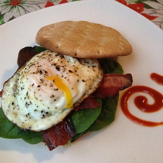 This Egg McFitFun includes 100-calorie potato sandwiching thin, low-sodium turkey bacon, fresh spinach, egg, and a little sriracha for a spicy kick.