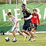 David Beckham with Brooklyn on the soccer field.