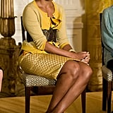 Michelle opted for a marigold blouse and cardigan combination from J.Crew to deliver a speech in the East Room of the White House in 2009, cinching her waist with a thick belt.