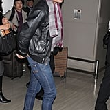 Zac Efron got off his flight from LA wearing jeans and a leather jacket.