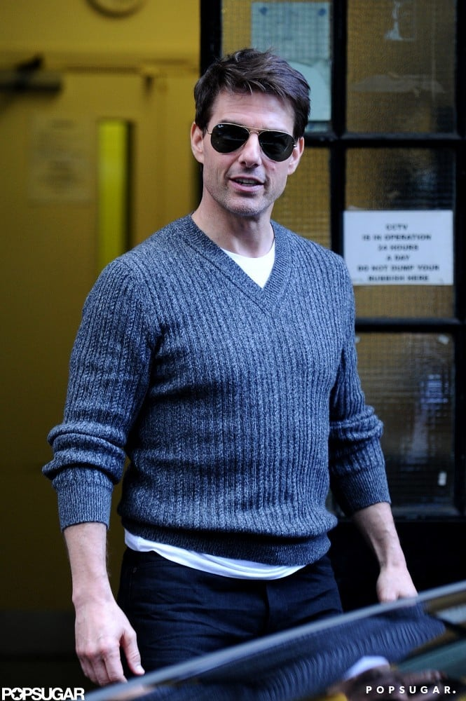 Tom Cruise cracked a smile leaving a meeting yesterday.