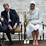 The royal couple smiled together as they took off their shoes to visit the Malaysian mosque.