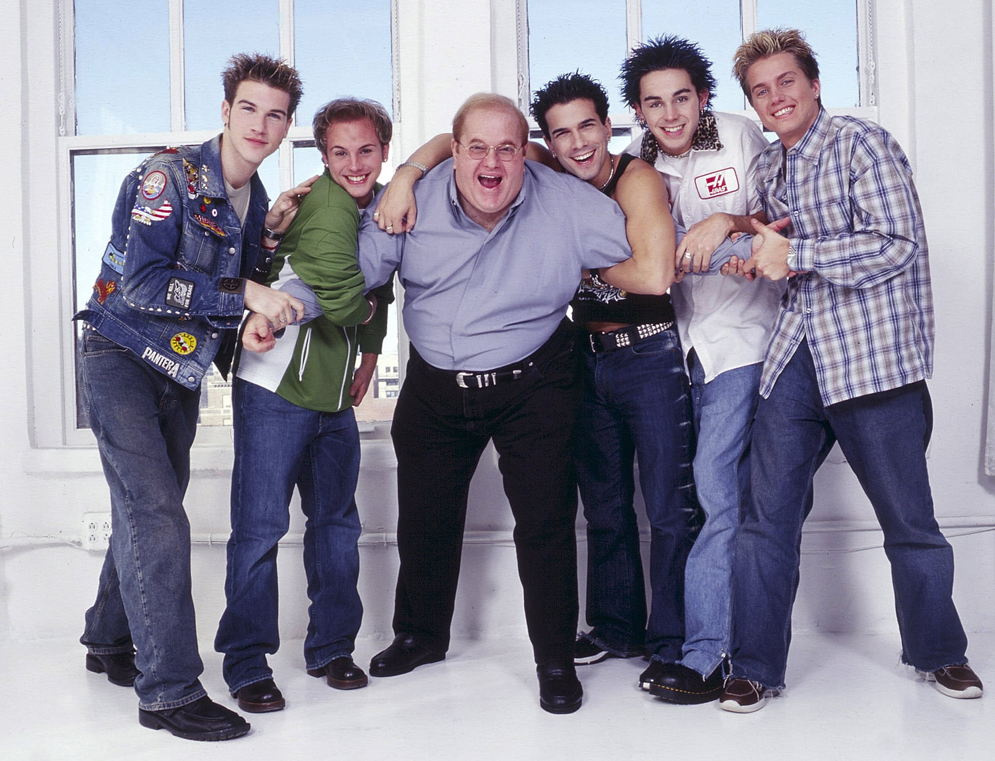 NEW YORK - CIRCA 2001: Lou Pearlman poses with boy band O-Town, Jacob Underwood, Ashley Parker Angel, Erik Estrada, Trevor Penick and Dan Miller seen in New York, circa 2001. (Photo by Mark Weiss/WireImage)