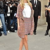 Poppy Delevigne arrives look as polished as every for Chanel.