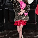 Suri Cruise pulled her fur coat tightly around herself.