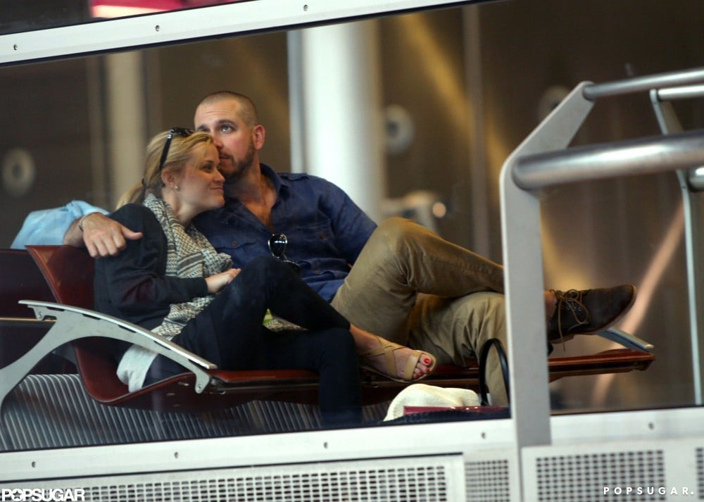 Jim Toth put his arm around wife Reese Witherspoon after flying to Paris in July 2011.