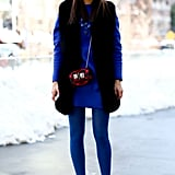 Bold cobalt looked gorgeous against a black furry vest — a testament to the power of color.
