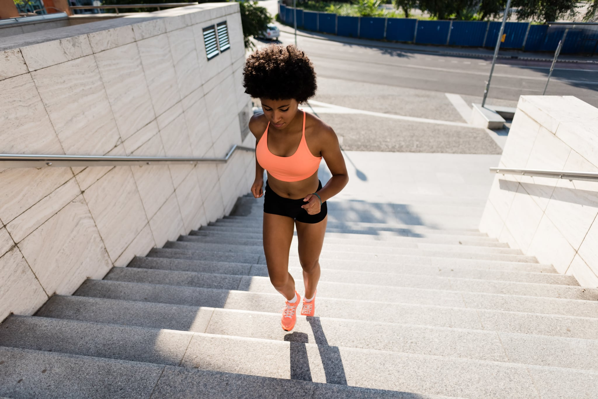 Healthy lifestyle sports woman running on stairway