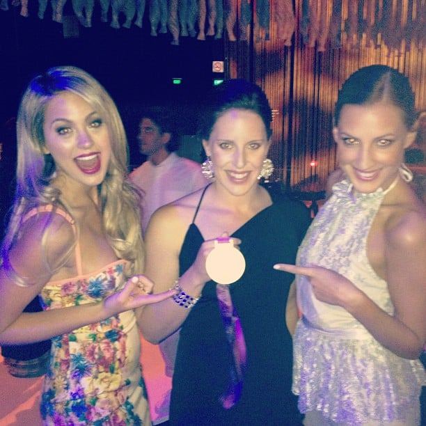 Jesinta Campbell and Laura Dundovic admired Alicia Coutts' Olympic gold medal at the Myer Spring/Summer 2012 collection launch. Source: Instagram user jesintac