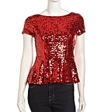 You're sure to turn many heads in this dazzling Casual Couture red sequined peplum top ($34, originally $118).