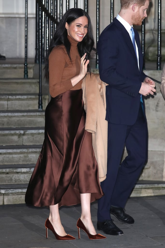 Meghan is also known to love a head-to-toe monochromatic look, as she's been spotted in sophisticated combinations like this chic one she wore to visit the Canada House earlier this year. For this outing, Meghan paired a fitted caramel turtleneck and a chocolate-brown satin skirt with matching suede pumps.