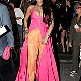 Rihanna Wearing a Pink Dress and Orange Pants in Seoul