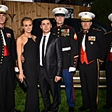 Costars Zac Efron and Taylor Schilling posed among Marines that were in attendence at the premiere for The Lucky One in LA.