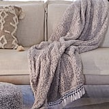 Amped Fleece Fringe Trim Throw Blanket ($59)