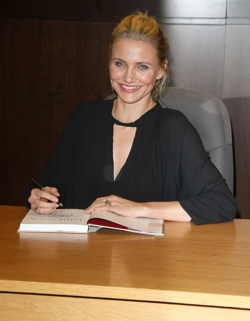 Cameron Diaz smiled at a signing for her new living tome, The Body Book, on Thursday in LA.