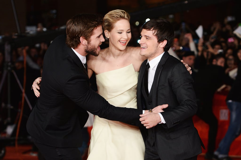 Liam Hemsworth and Josh Hutcherson sandwiched Jennifer Lawrence at the Rome premiere of The Hunger Games: Catching Fire in November 2013.
