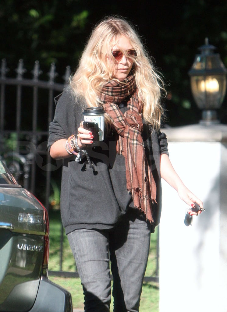 Mary-Kate Olsen clutched her necessities, coffee and BlackBerry, leaving a friend's house in Santa Monica yesterday. She has been on the West Coast for the past few weeks, which meant missing the huge snowstorm that hit NYC this weekend. With 2010 coming to a close, Mary-Kate and Ashley can look back on a huge 12 months for their ever-expanding fashion empire. 2011 will also mean a return to the big screen for Mary-Kate, whose movie Beastly will hit theaters in March after being pushed back from last Summer. This year also saw the end of MK's relationship with Nate Lowman so she is cruising into the New Year as a single woman.
