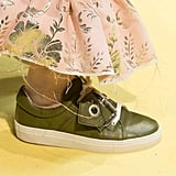 A buckled sneaker in a lovely shade of olive green.
