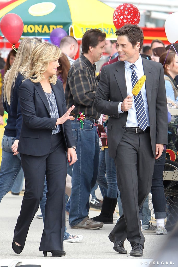 Amy Poehler and Rob Lowe filmed scenes at a carnival.