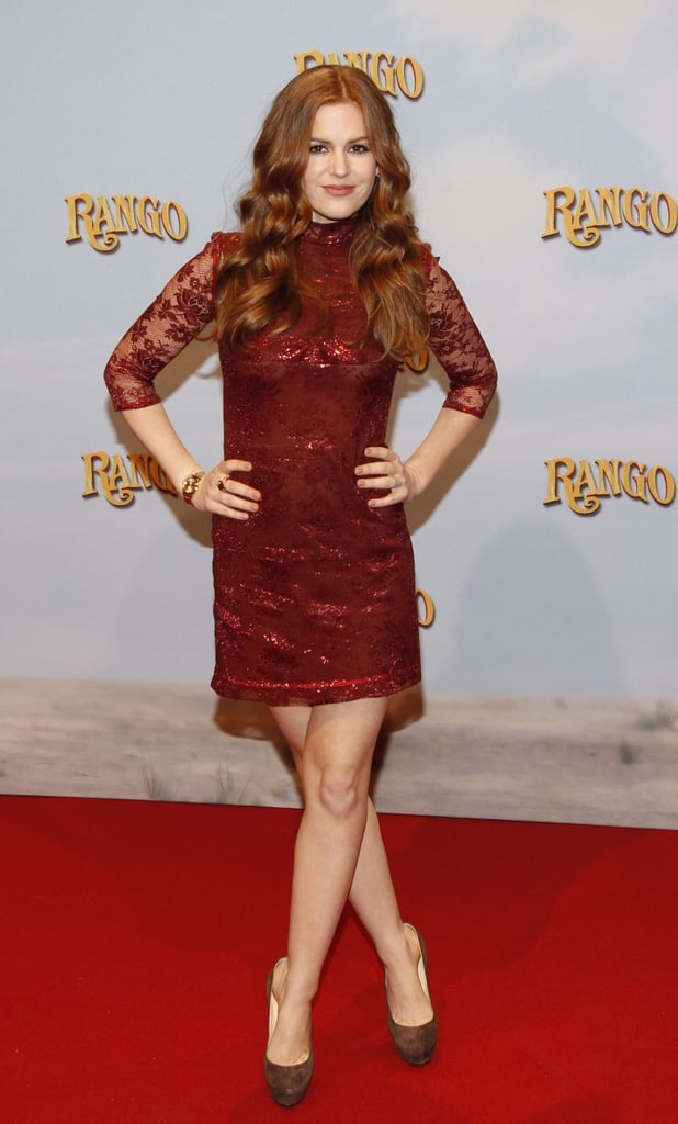 Isla Fisher posed in a lacy dress at the Berlin premiere of Rango yesterday. Her costar Johnny Depp didn't join her on the red carpet, though she did have the film's director, Gore Verbinski, by her side. She and Johnny made a cute duo when they showed off the movie in LA last week after promoting together at the press junket. Isla's on the go until the animated feature hits theaters on March 4, but she still makes time for mom duty. We even got our first peek at Isla and Sacha's adorable younger daughter during a recent outing with Olive.