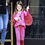 Suri Cruise played with a wand outside of Starbucks.